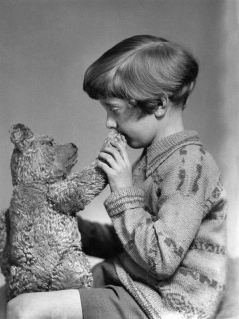 Long ago picture of Christopher Robin and his pet bear.